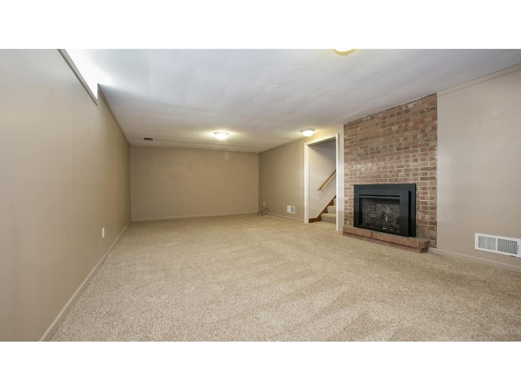 family room 12' x 24 for more than one sitting/usage area. Fireplace has a newly installed gas system.