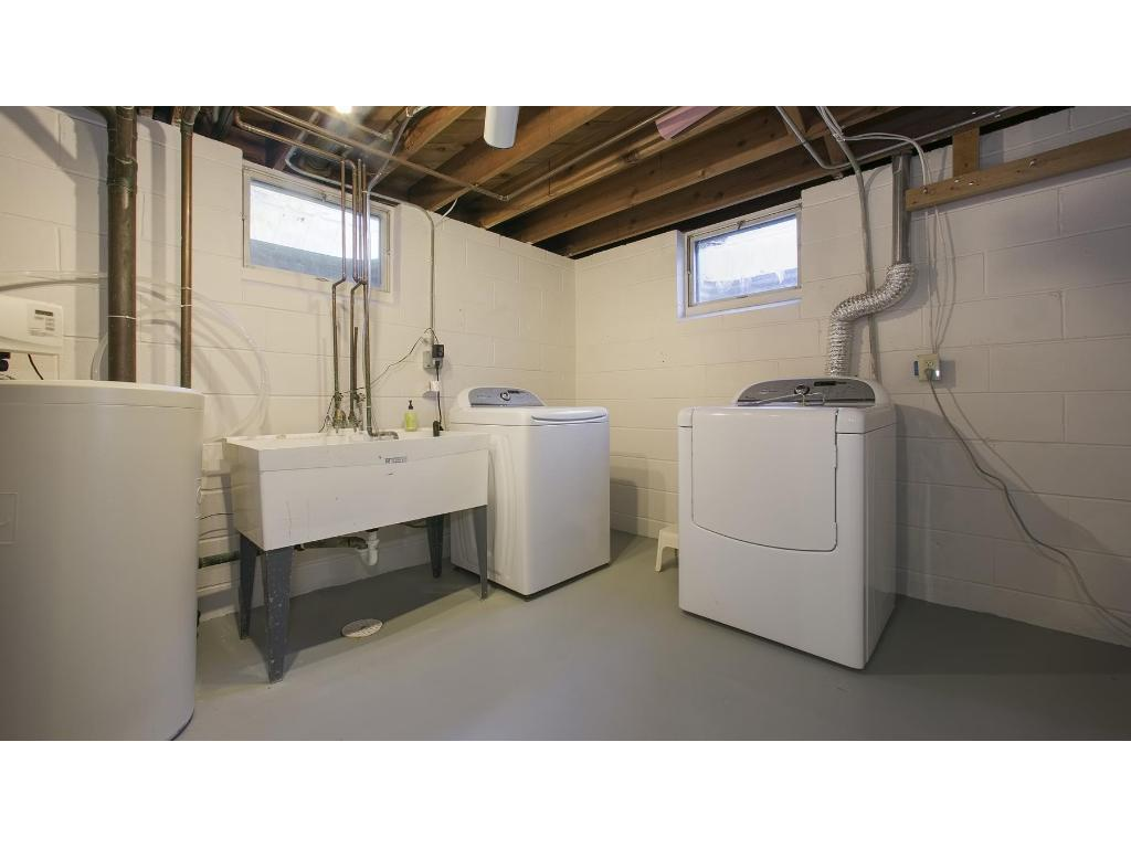 newer washer/dryer in clean spacious laundry area