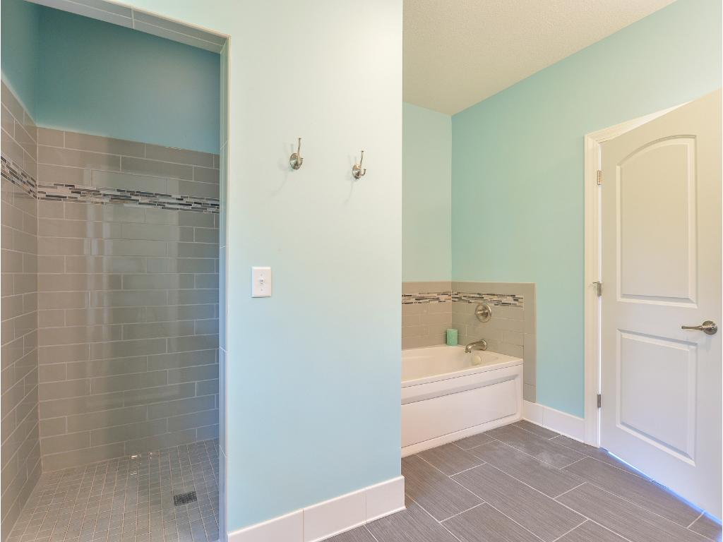 Master Bath  - Separate Tub and Shower Stall + separate/enclosed Water Closet stall. Beautiful use of Tile and lighting.