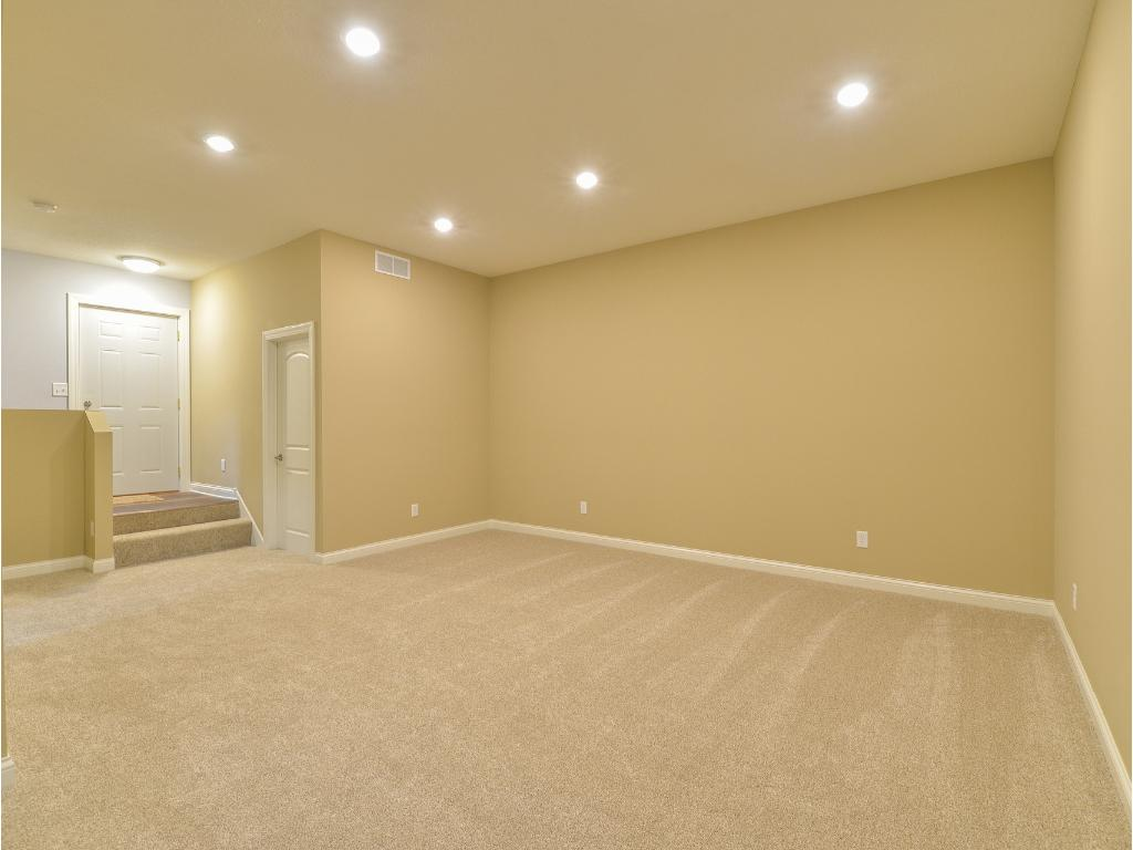 Lower Level Family Room features 10' High Ceilings, Recessed Lighting.  Not pictured is the massive under stairs storage closet