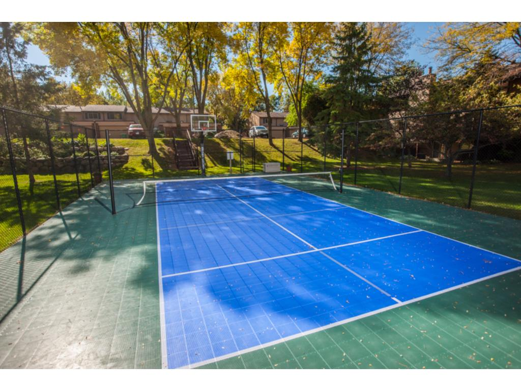Shared sport court with tennis and basketball
