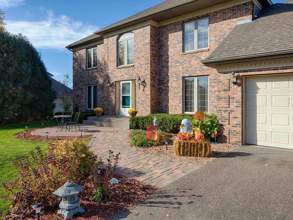 Paver walkway and patio, mature landscaping, trees with gorgeous fall colors.
