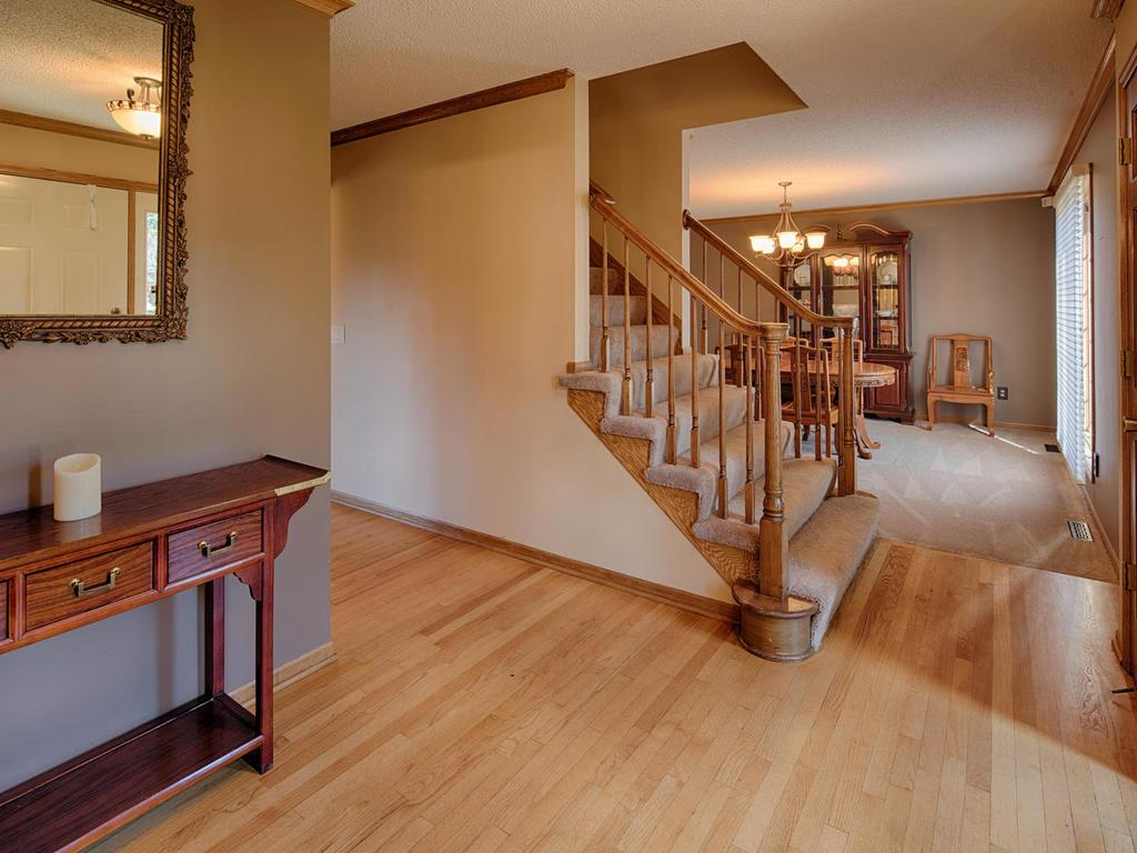 Go the the formal living room, formal dining, kitchen/informal dining or up the stairs upon entering the home.