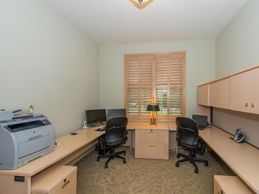 Right off the Foyer is the 13x11 Office that has French doors and custom plantation shutters.