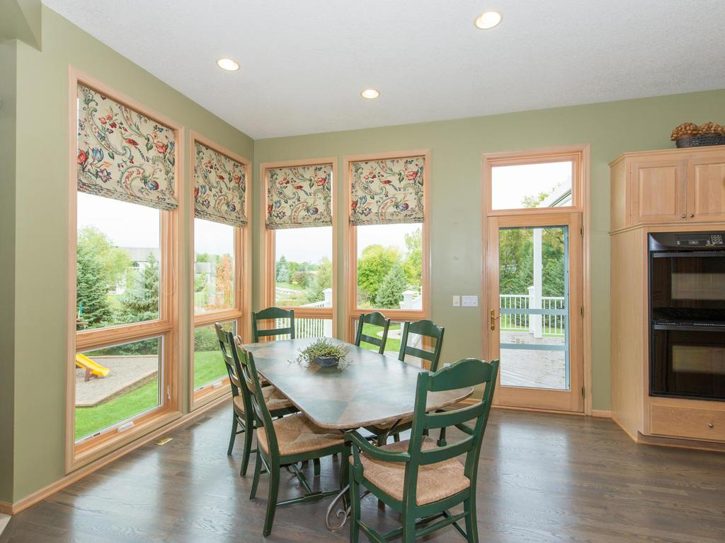 The adjoining Breakfast Area has 9' windows for a wonderful view of the private Backyard and has a glass door leading to the newly stained Deck with pergola.