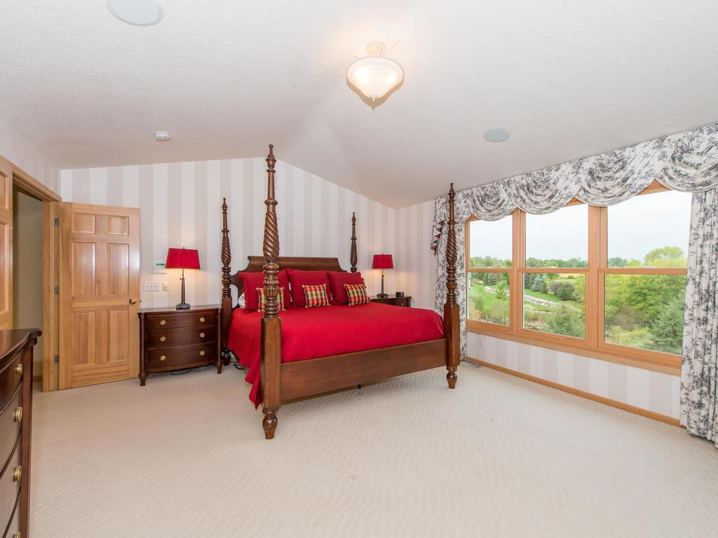Retreat to the spacious professionally painted Master Suite with its vaulted ceiling, his & hers walk-in closets, and a private Full Bath with his & hers vanities, whirlpool tub, and separate shower.