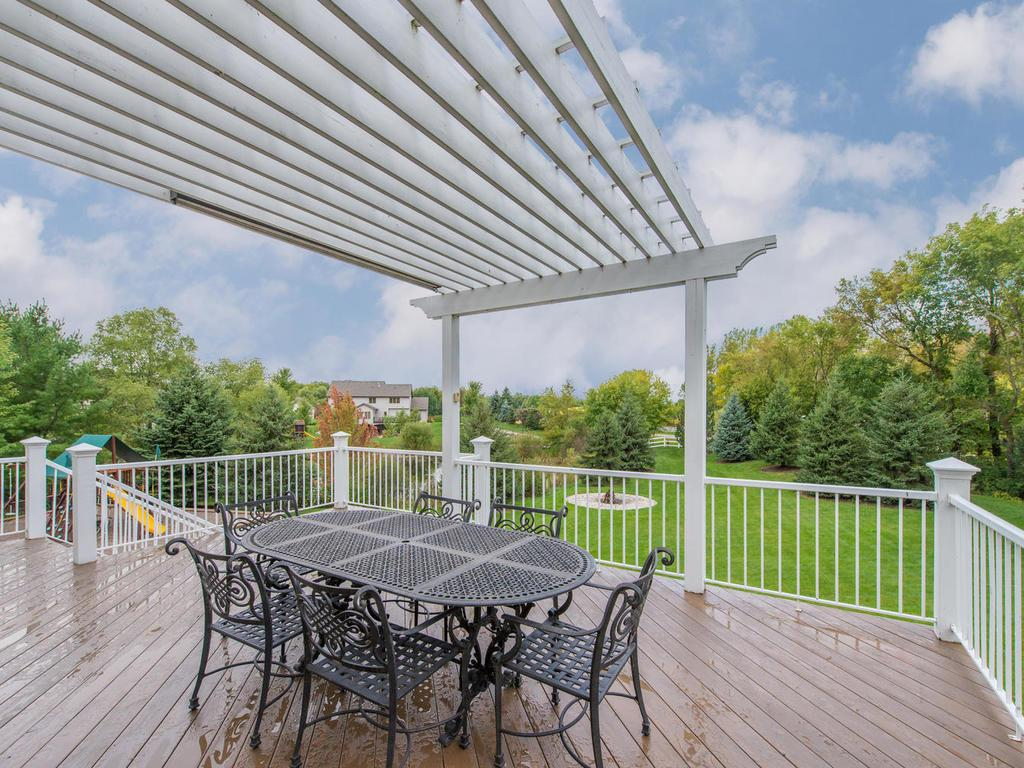 The 28x17 Deck and pergola are newly stained and provide great outdoor entertaining space! Stairs lead down to the large flagstone Patio and spacious private Backyard.