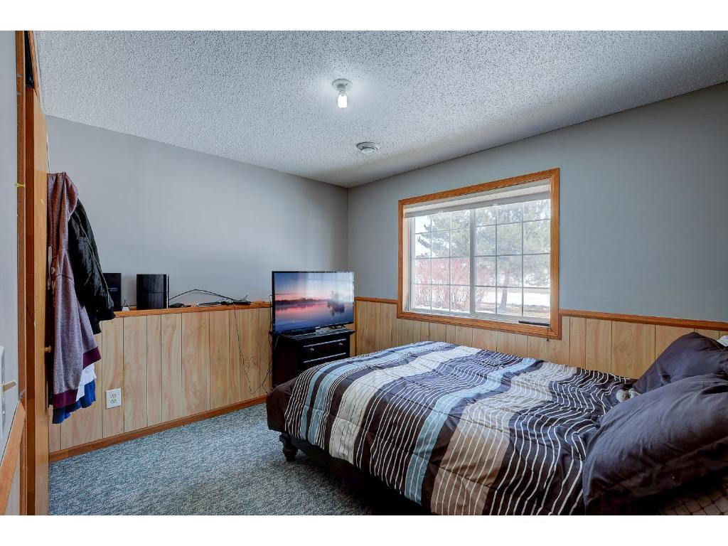 5BR split level home with quick access to Hwy 10, Big Lake Schools and  shopping. Walking paths just out your front door.