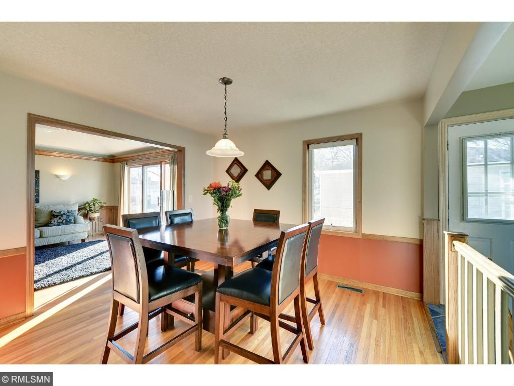 Spacious dining room w/ hardwood floors located just off the kitchen