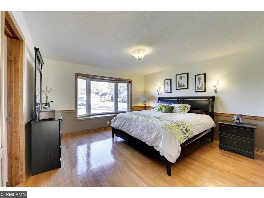 Main level master bedroom w/ hardwood floors and master walk thru bath w/ walk in closet.