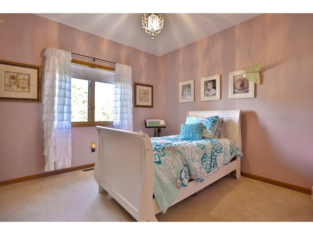 Very cute bedroom with lot's of room.