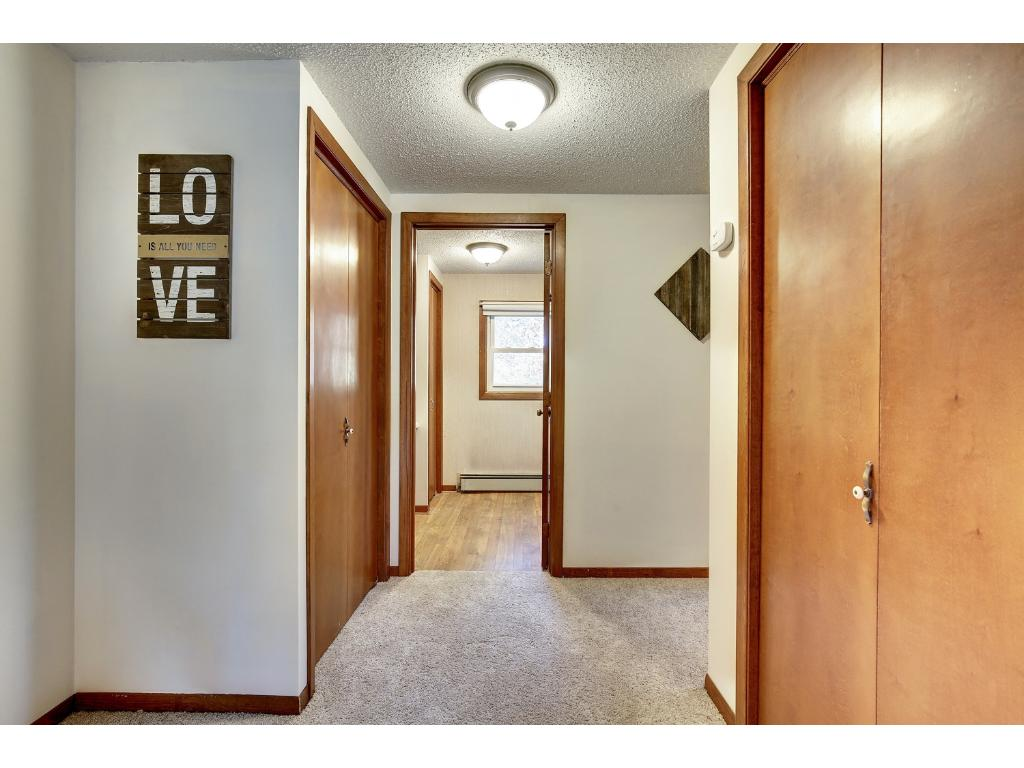 Generous hall space connects bedrooms and full bathroom.