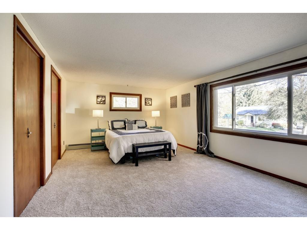 Large master bedroom with two closets and plenty of space for a sitting area.