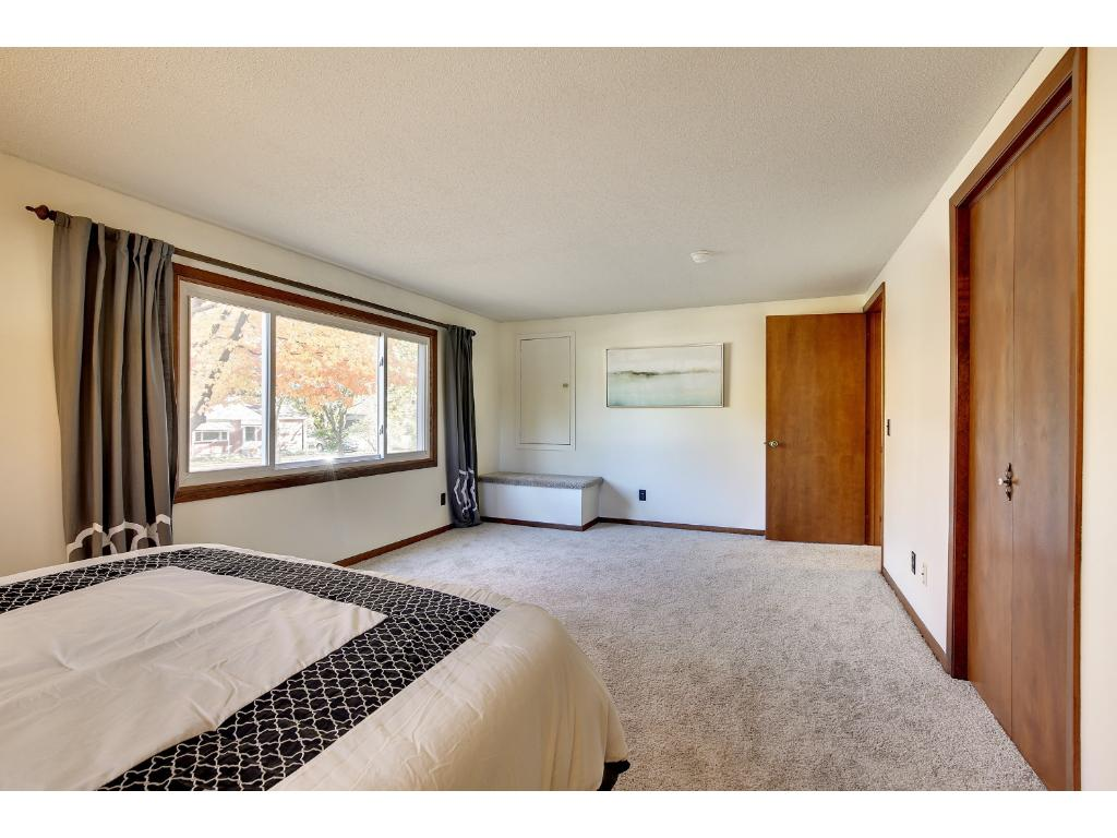 Large master bedroom windows welcome the eastern morning sun.