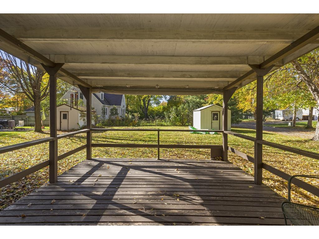 Covered back deck over looks the large backyard.  There are two sheds in the backyard.  Yard size is 85x132  (quarter of an acre).