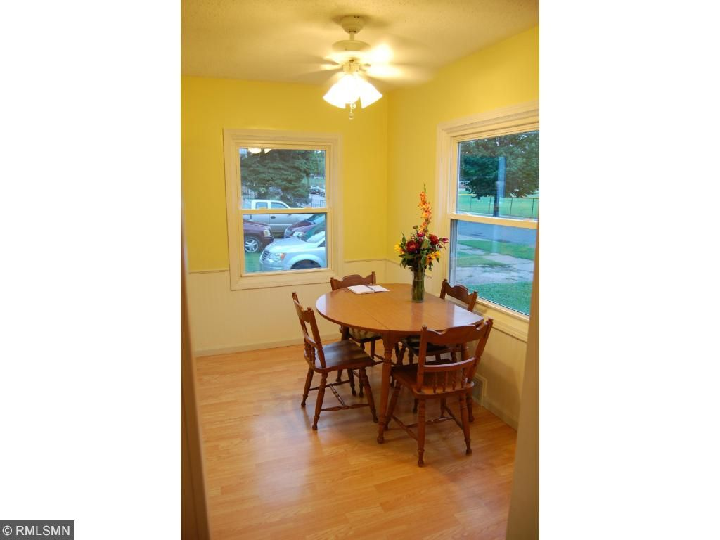 Turn right and step into a roomy and bright dinette with a lighted ceiling fan and a kitchen that will not disappoint