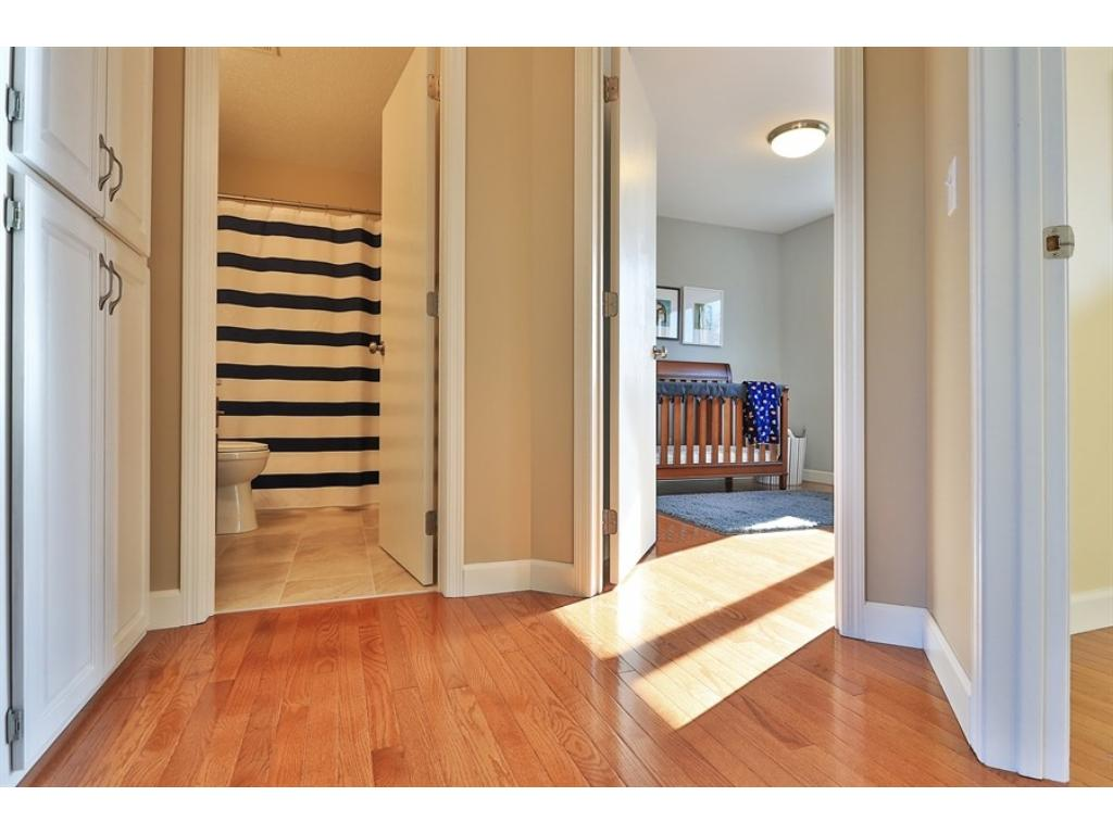 New hardwood floors throughout upstairs bedrooms and hallway give this home a fresh, updated look.  Clean and simple, yet tons of charm.