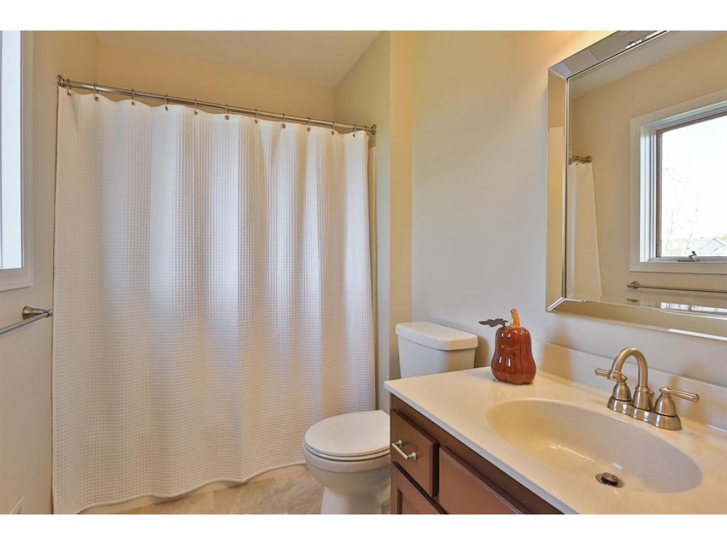 Recently updated master bathroom is a private oasis.  New flooring, cabinetry and countertops.