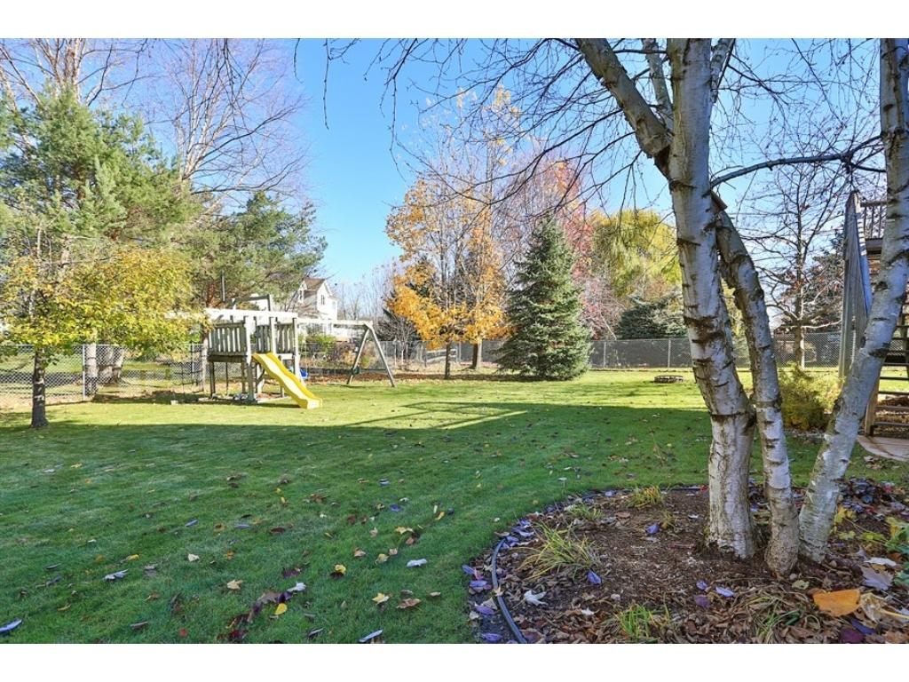 Large, flat, fenced backyard is perfect for kids and pets.  Enjoy yard games all year round.
