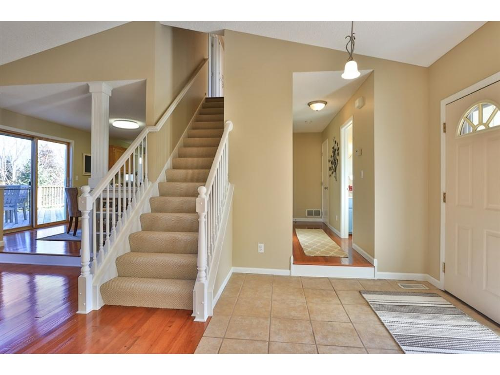 Welcome to this large and inviting home.  New paint, carpet, hardwood floors upstairs and open spaces greet guests and family.