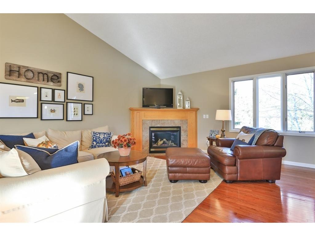 Oversized living room is great for hosting large and small groups.  Great floor plan and easy to be part of the activity in the kitchen.  Gas fireplace is warm and cozy- curl up and read your favorite book.