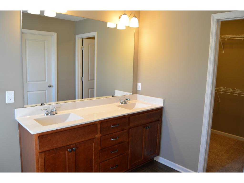 Another view of this wonderful private bathroom. Notice the walk-in closet conveniently located off this space.