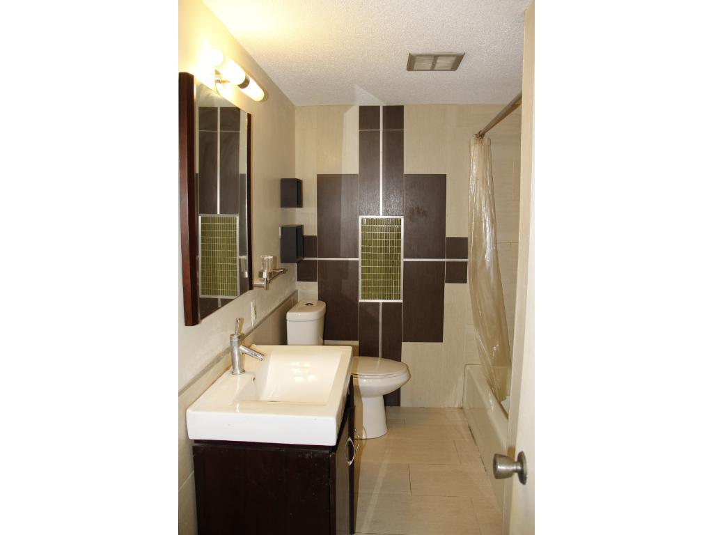 Main bath with contemporary design features. Condo has two full bathrooms.