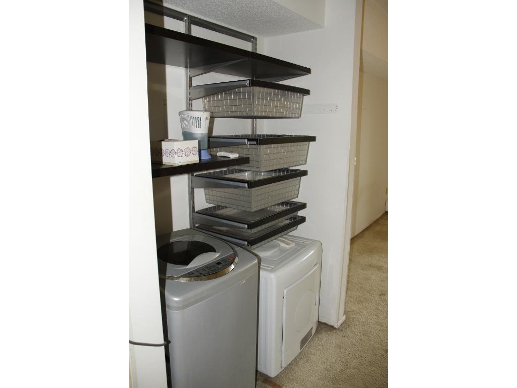 Master closet has apartment sized washer and dryer. TISH calls for removal since they are inappropriately hooked up according to the city.