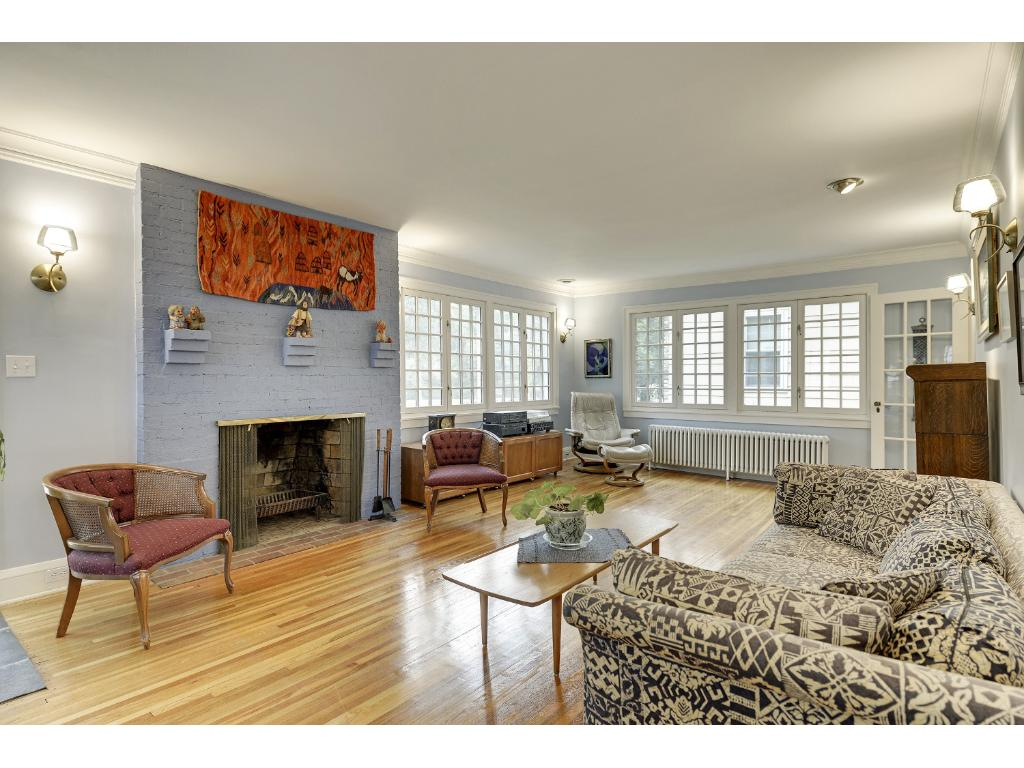 Large living room with several large windows overlooking the Minnehaha Parkway.
