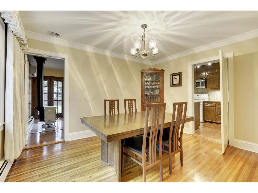 Formal dining with built in corner hutch.