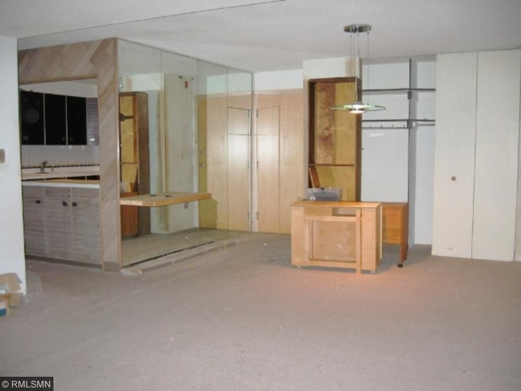 Dining room as seen from living room, entry to condo, kitchen to the left.