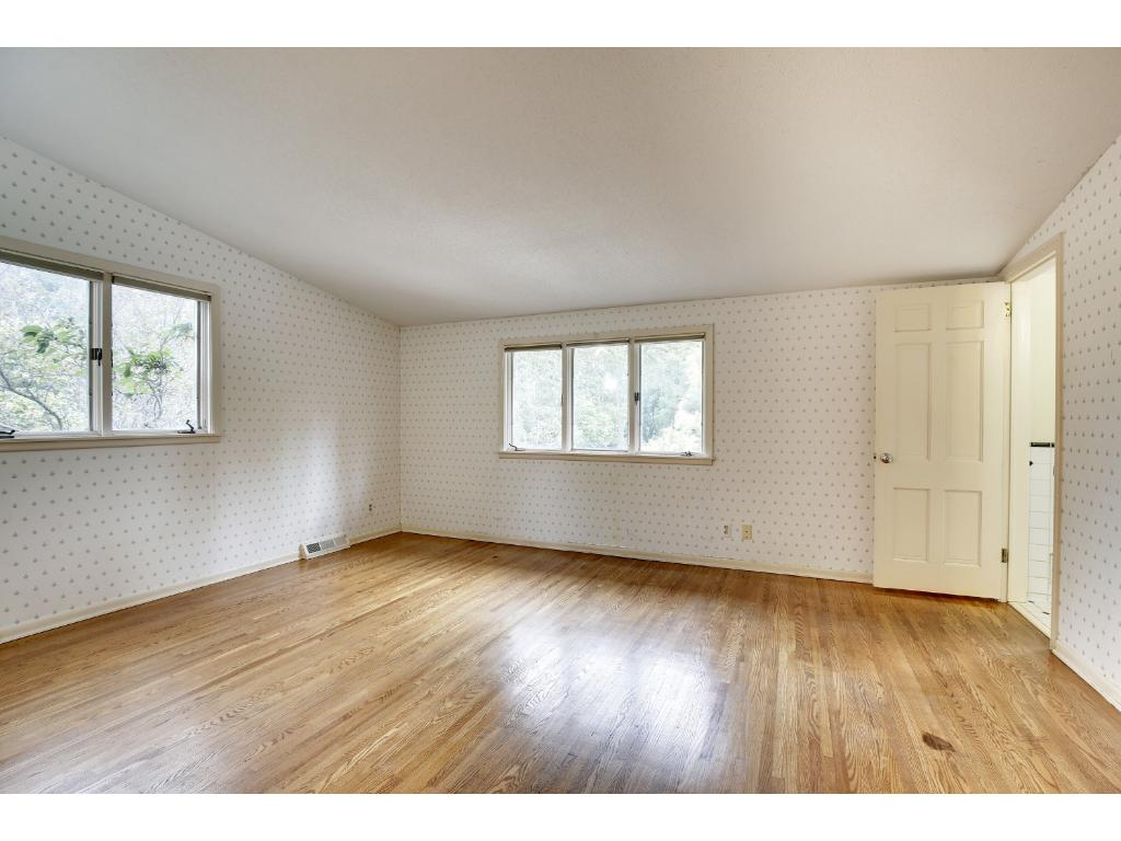 The master bedroom has a northwest exposure and features a vaulted ceiling and hardwood floors