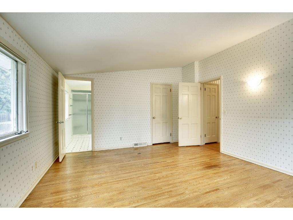 There are two wall sconces, a large 7x6 walk-in closet and an adjoining private master bathroom