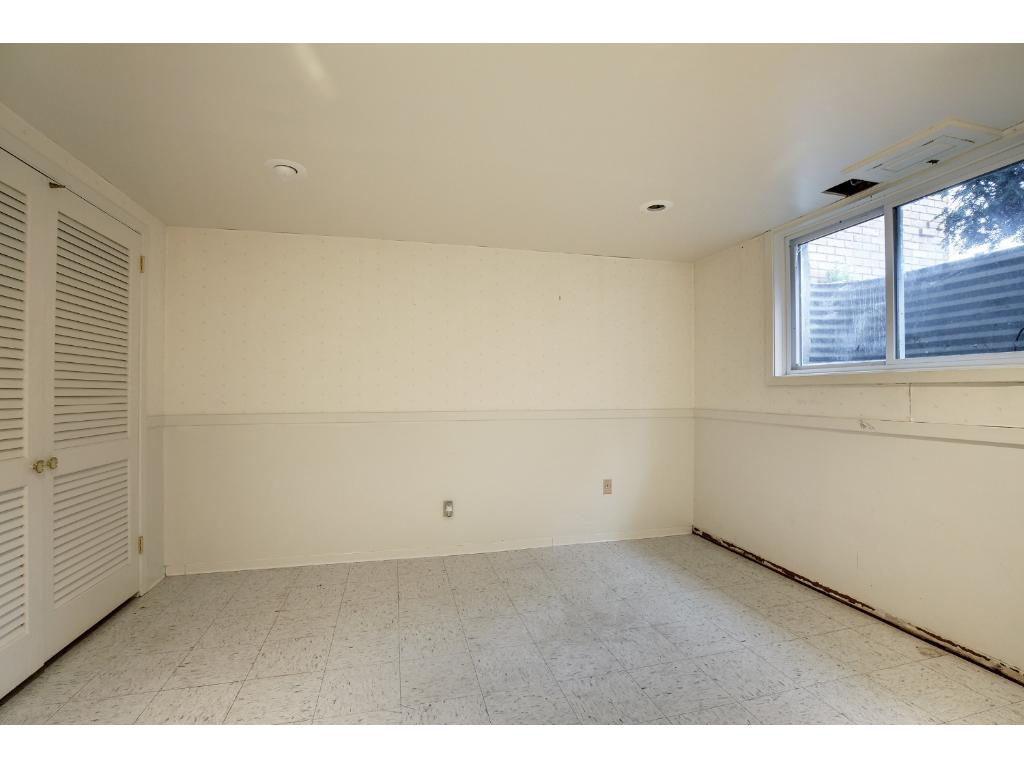 The fifth bedroom is located in the lower level and has a south facing egress window