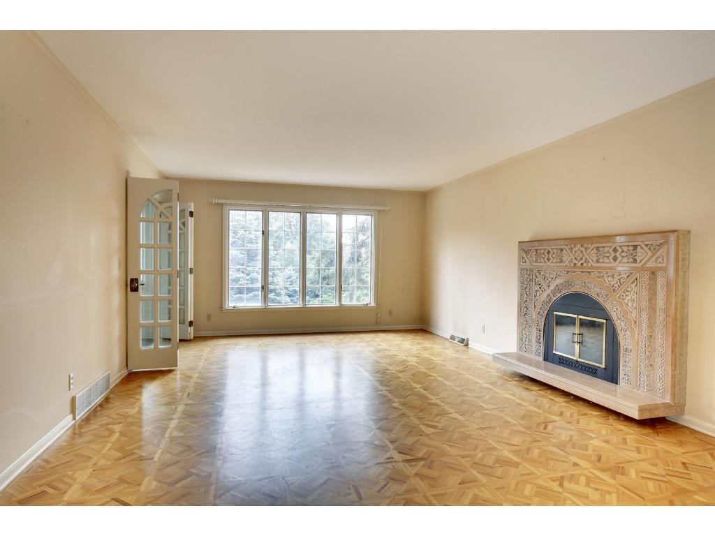 This space has plenty of room for a grand piano and is filled with tons of natural light