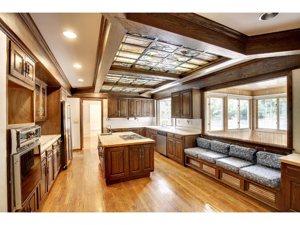 There are also dual sinks, dual ovens and a spacious informal dining area with a large built-in bench
