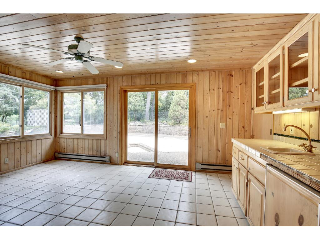 The 17x12 sunroom opens out to the pool and has a wet bar with a built-in Sub-Zero refrigerator and freezer