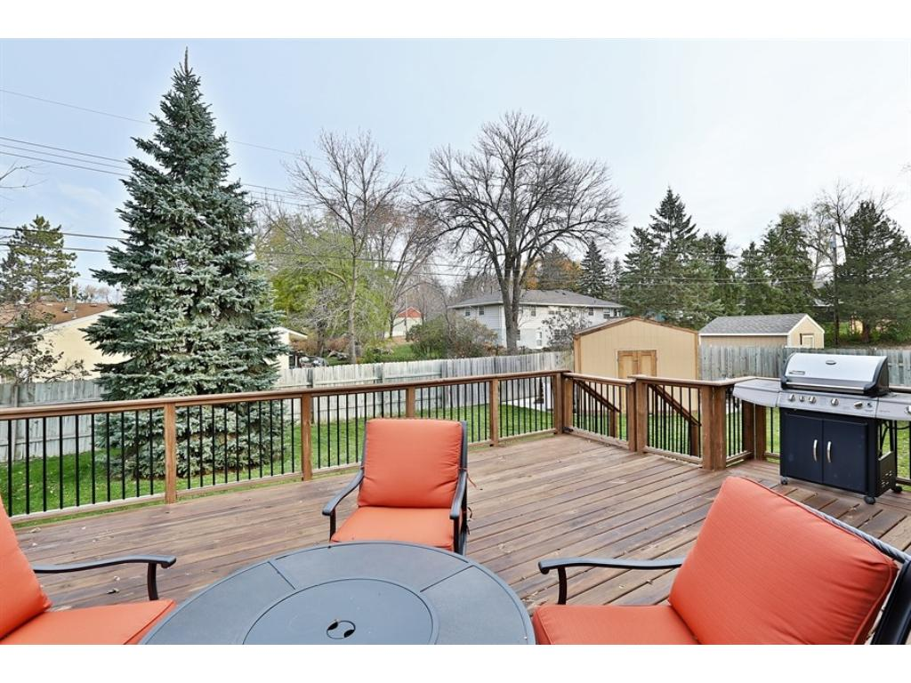 View from the deck into the nice sized backyard with privacy fence+invisible fence.