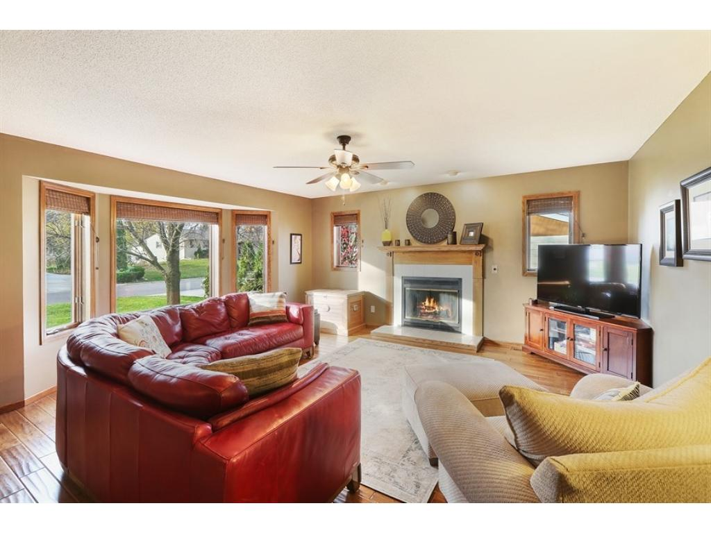 Wonderful living room is filled with windows and offers hand-scraped floors and wood-burning fireplace with blower for superb heat circulation. Fireplace is also plumbed for gas for easy conversion if desired.