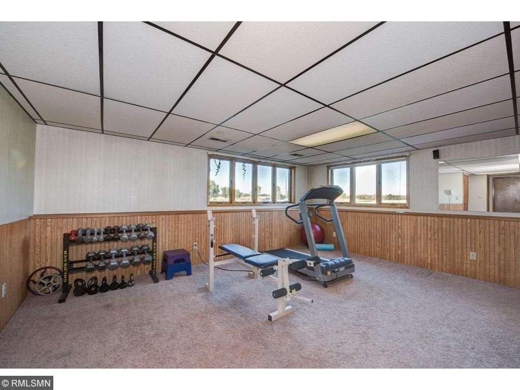 Half Of Family Room Currently Used As Exercise Room
