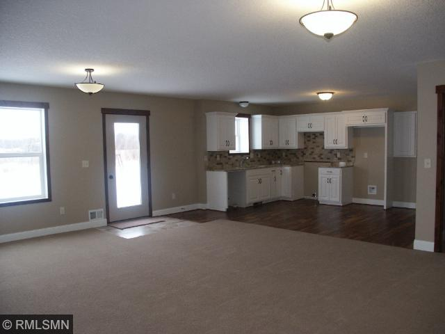 Walk out lower level has Mother-in-law apartment with separate entrance from garage and walkout to back yard and has a kitchen large living/family room 2 large bedrooms, full bath, laundry hook up, huge mud room, unfinished future theater room area.