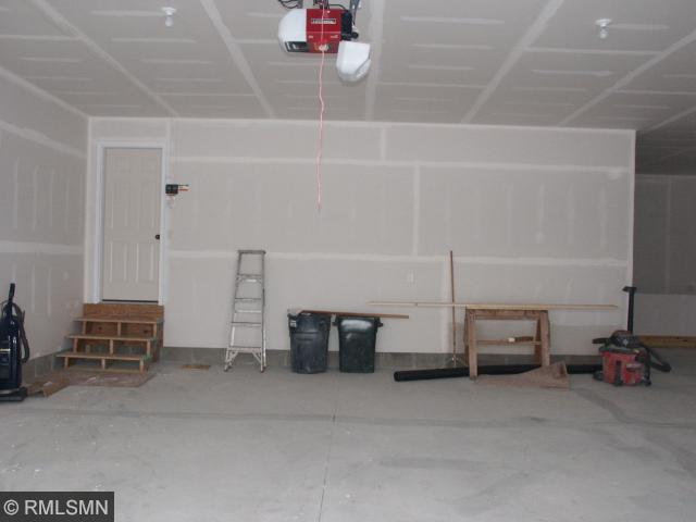 Garage is 36 x 28 with X-deep 3rd stall with approximate additional 10ft; Garage walls are insulated, 8?? overhead doors with 3rd stall 10 ft. wide door with additional length for all the toys, and stairs down to basement area