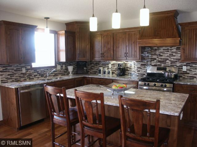 Gourmet Kitchen with custom Alder cabinets; Granite counters; 5 Burner Gas Stove, 2 ovens, SS appliances, under counter lights, kitchen/dining/living room is very open yet kitchen is hid from entry way...