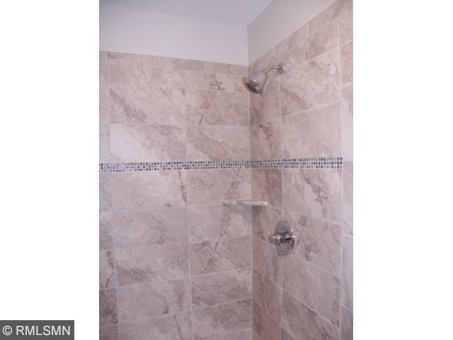 Separate MST shower, showers faucets have thermostat and volume control knobs