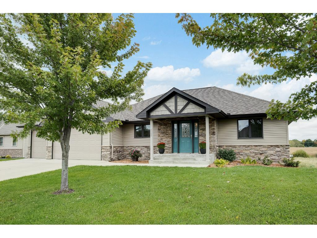 Welcome to 4948 Kassel Avenue NE! Your custom home without the wait or expense.