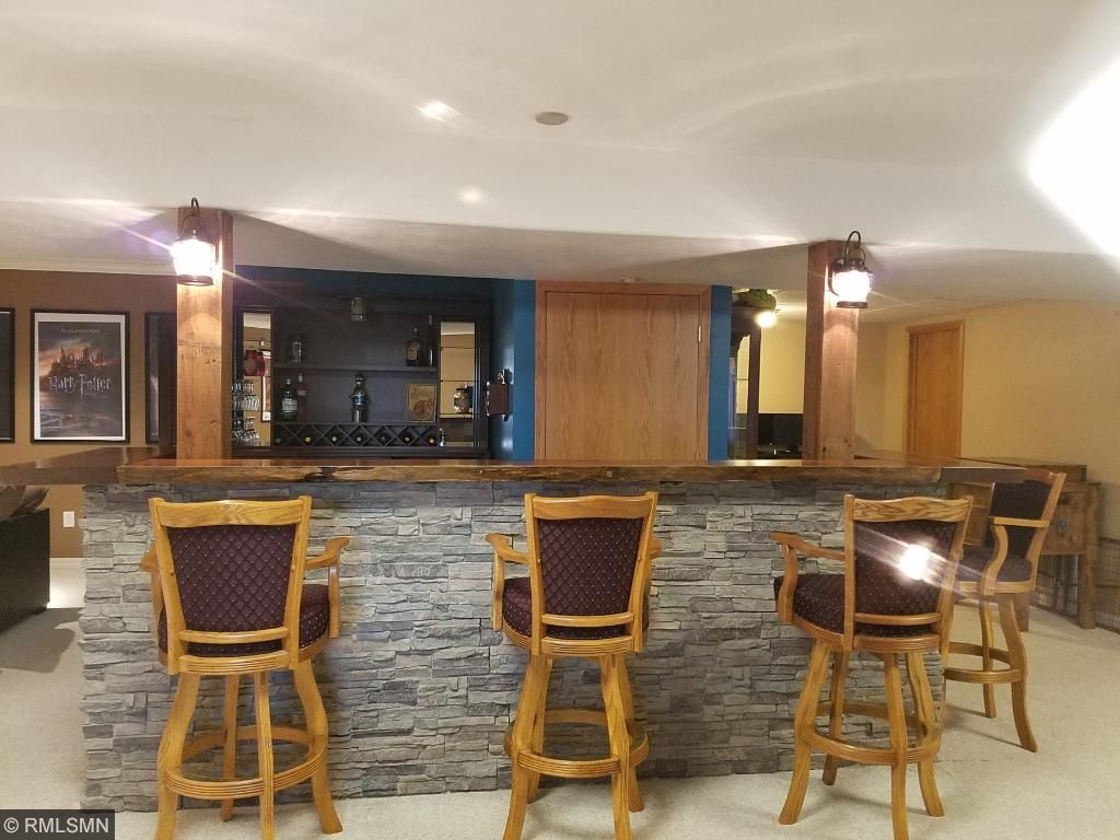 Lower Level Bar with stone accents and wood bar