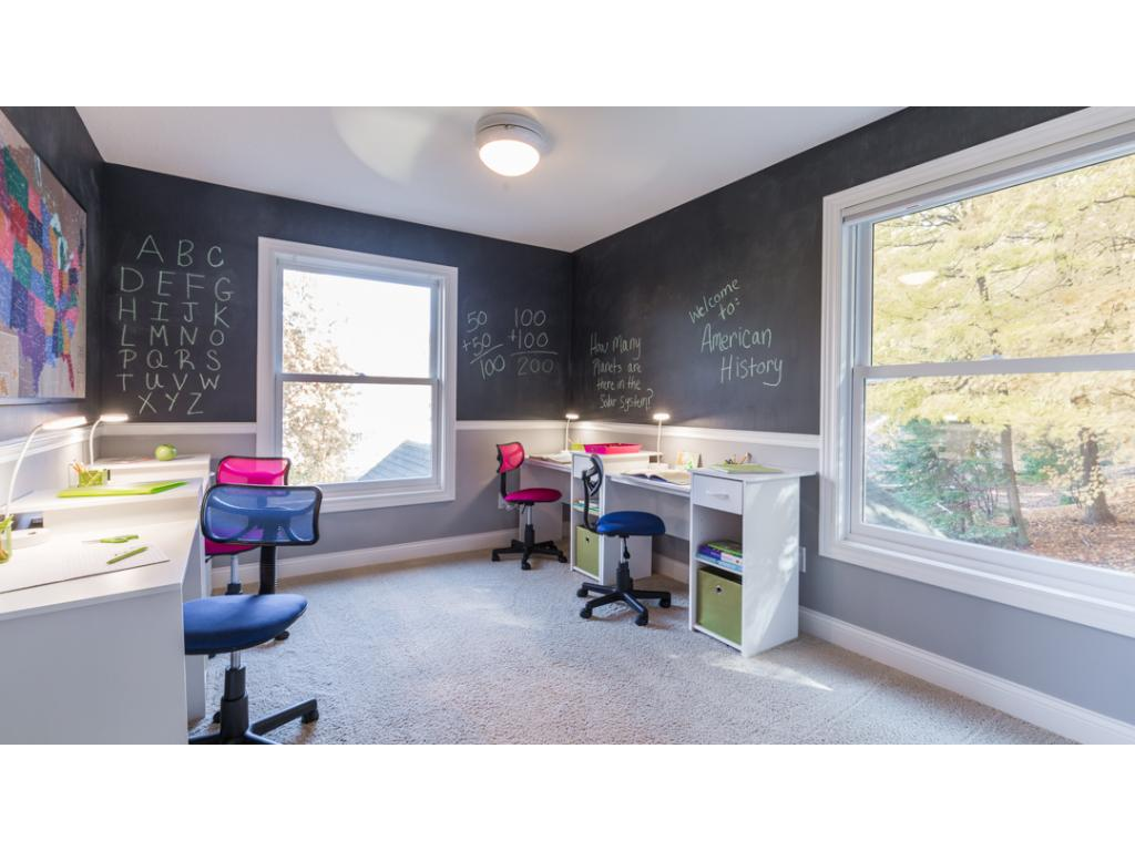 3rd junior bedroom offers dual large bright windows & chalkboard wall.