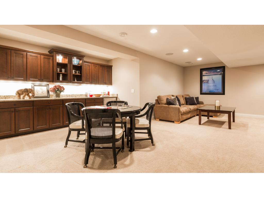 Lower level is the perfect hang out spot or relaxation retreat! Recreation room w/a dry bar that includes an abundance of storage, granite counter, under cab lighting & built-in fridge. Family room has built-in wall & ceiling surround sound speakers.