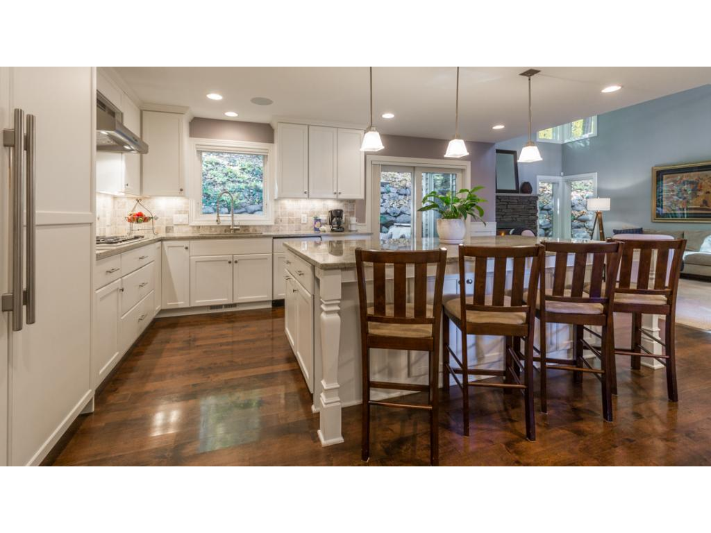 "Amazing kitchen has so much to offer! High-end Thermador appliances including built-in 48"" refrigerator w/ice-maker & custom wood door panels, stainless steel self-cleaning double wall oven, 5-burner gas cooktop & more. Giant island w/seating for 6!"