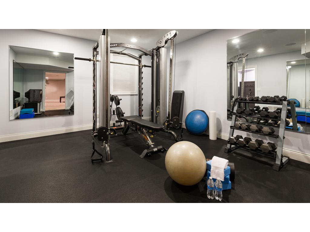 No need to spend on a gym membership w/ your own in-home gym! Features rubber flooring & all the space you would need for your exercise equipment! Nearby utility room also provides access to the garage.